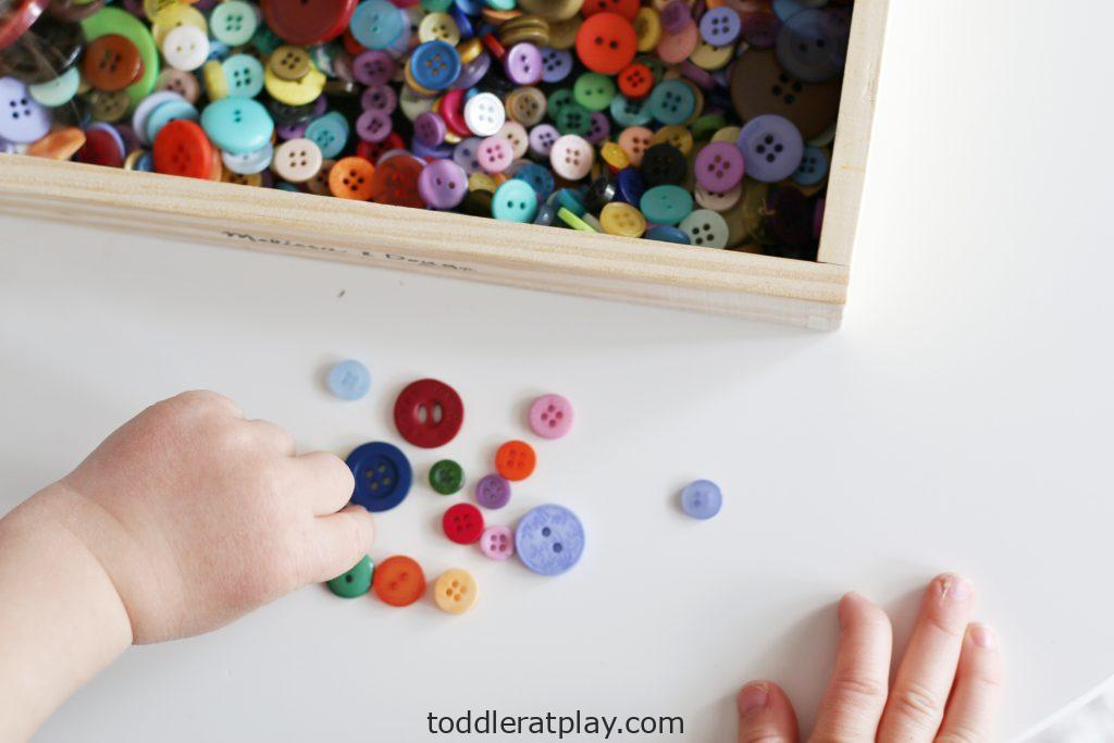 button sorting by the hole- toddler at play (6)