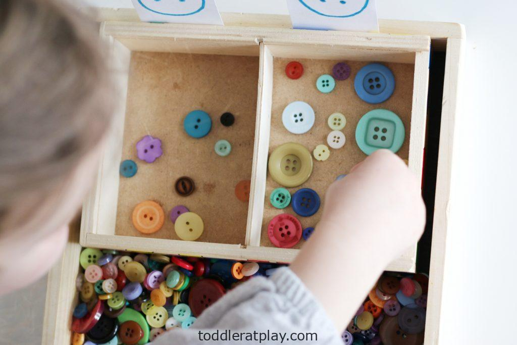 button sorting by the hole- toddler at play (7)