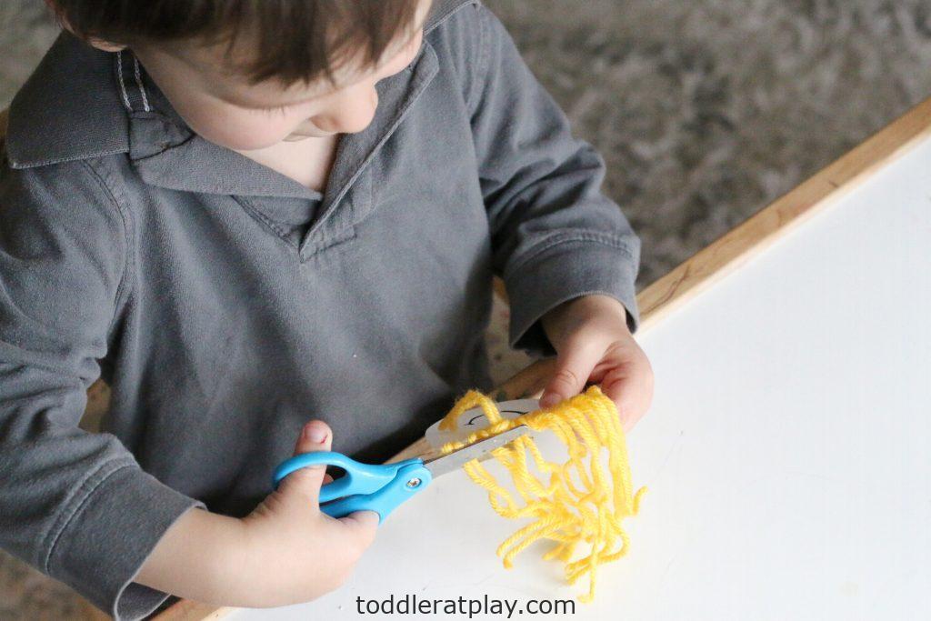 yarn hair cutting activity- toddler at play (5)
