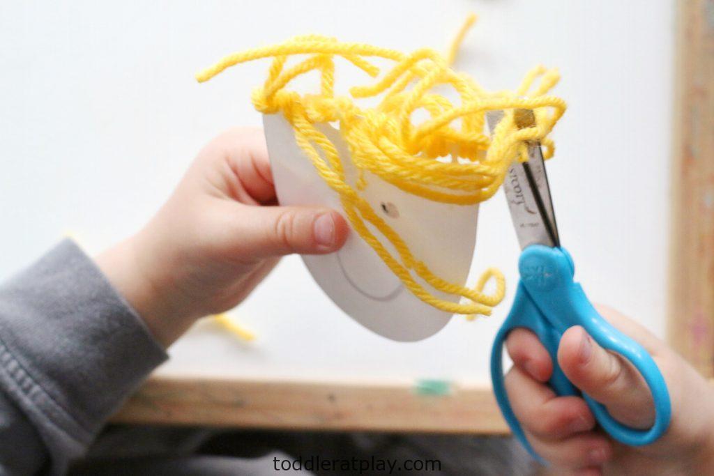 yarn hair cutting activity- toddler at play (8)