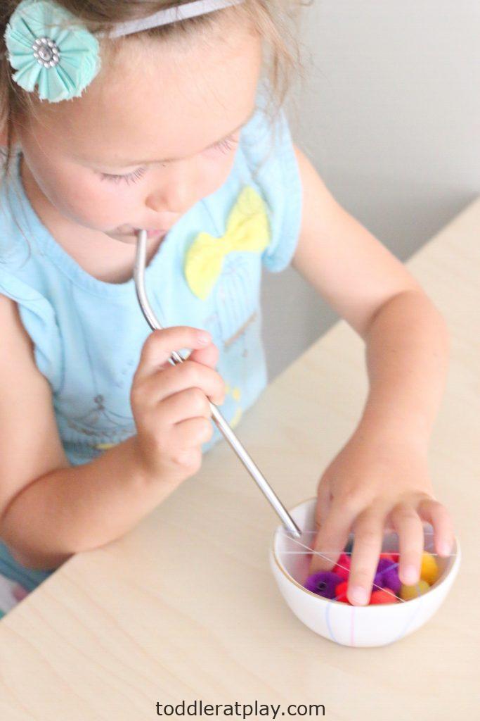 pom-pom straw pull- toddler at play (11)