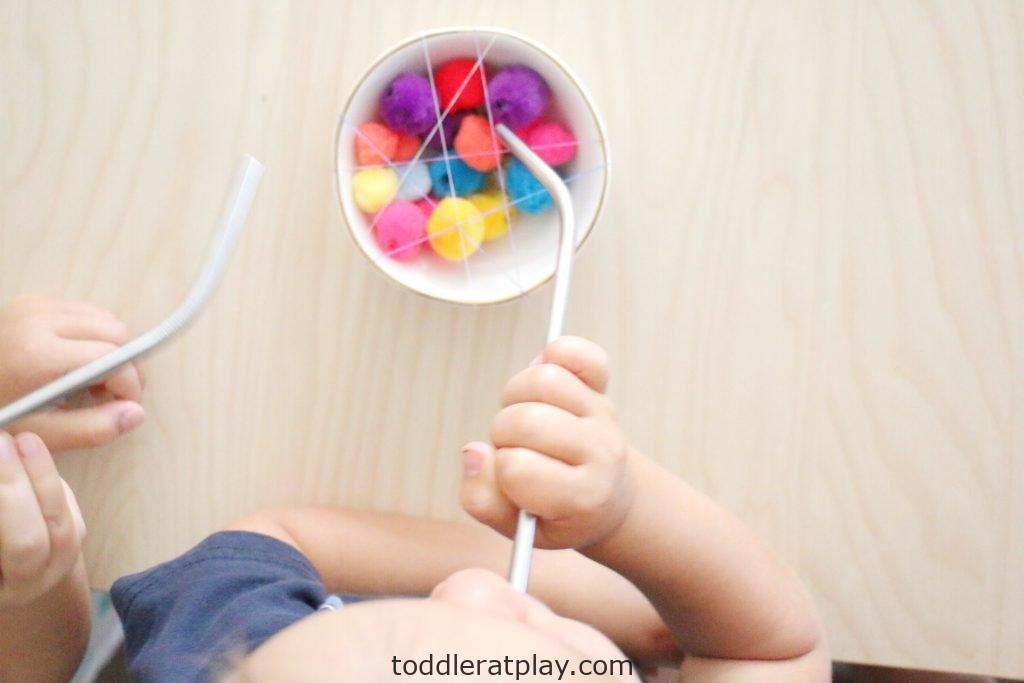 pom-pom straw pull- toddler at play (12)