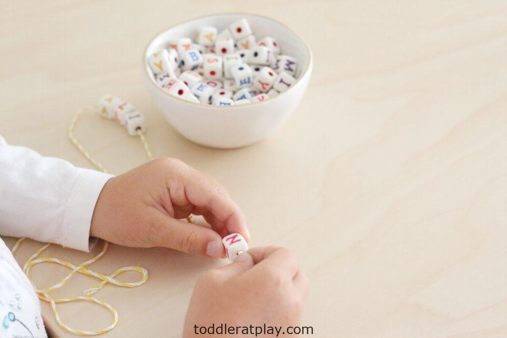 letter bead threading- toddler at play (16)
