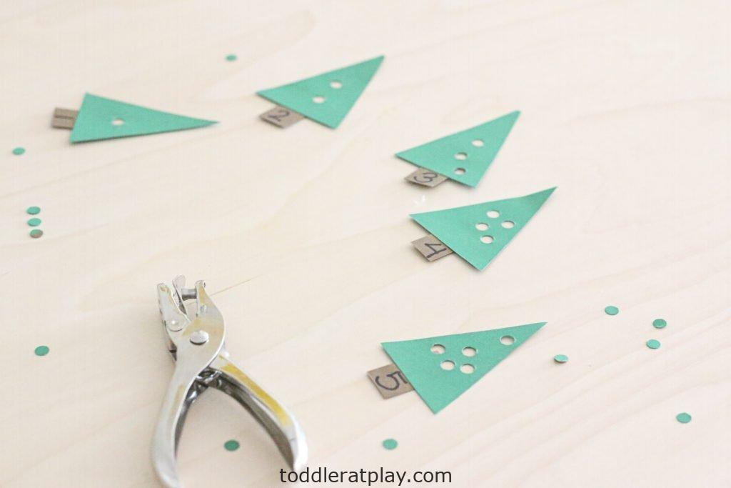 christmas tree hole punching activity- toddler at play (11)