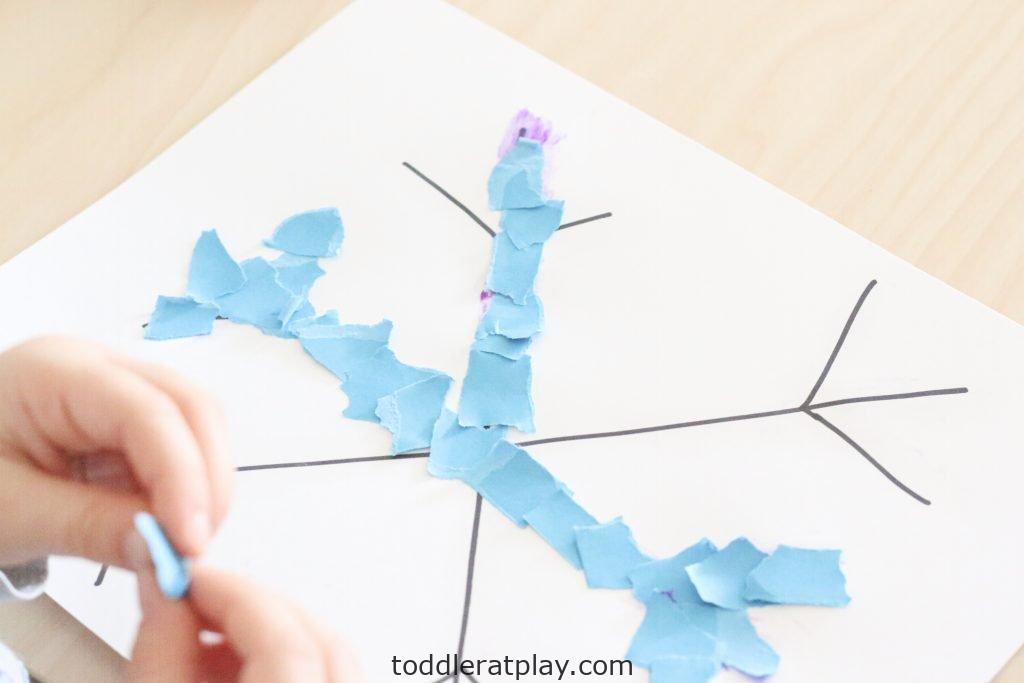 torn paper snowflakes- toddler at play (1)