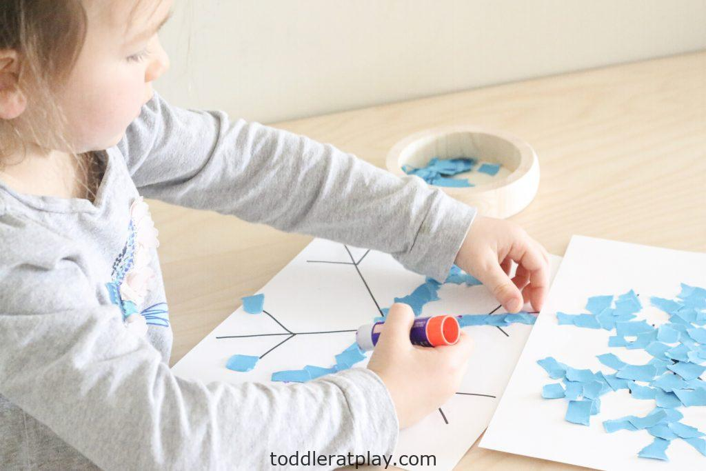torn paper snowflakes- toddler at play (10)