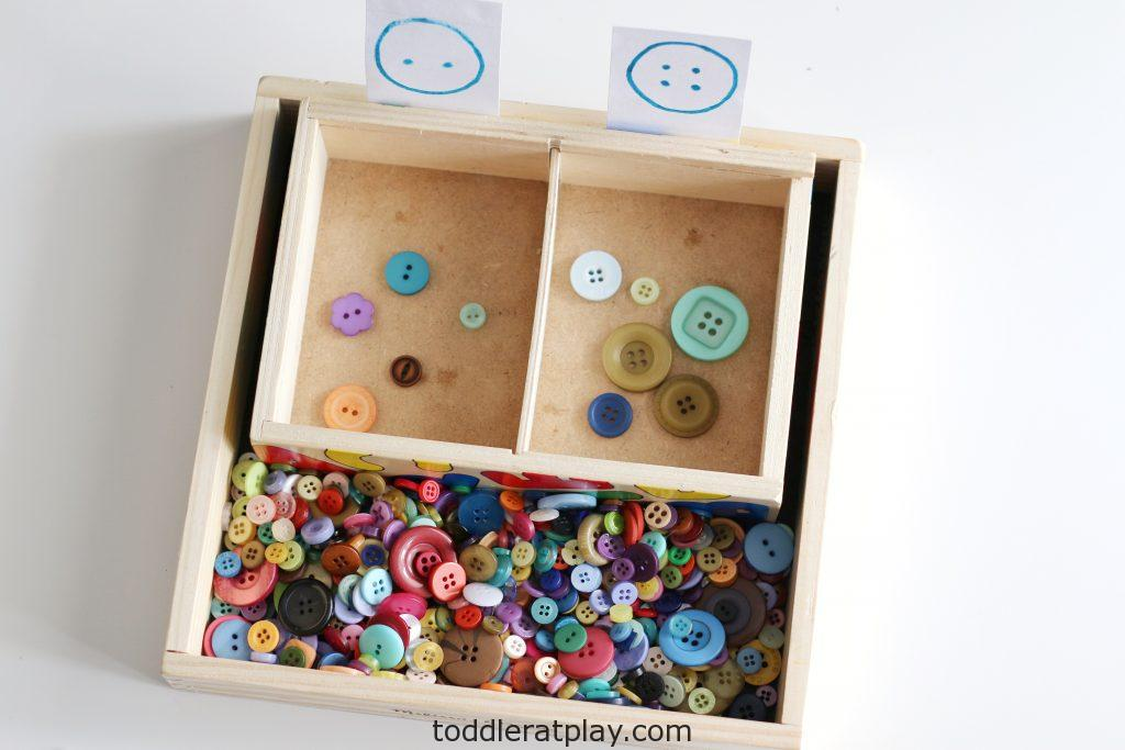 button sorting by the hole- toddler at play (2)