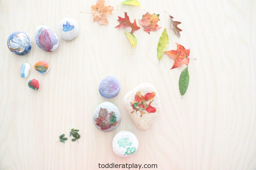 leaf prints on stones- toddler at play (9)